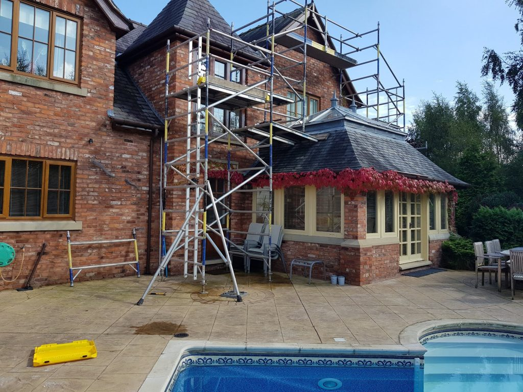 Exterior painting - rear of property, with scaffolding for access